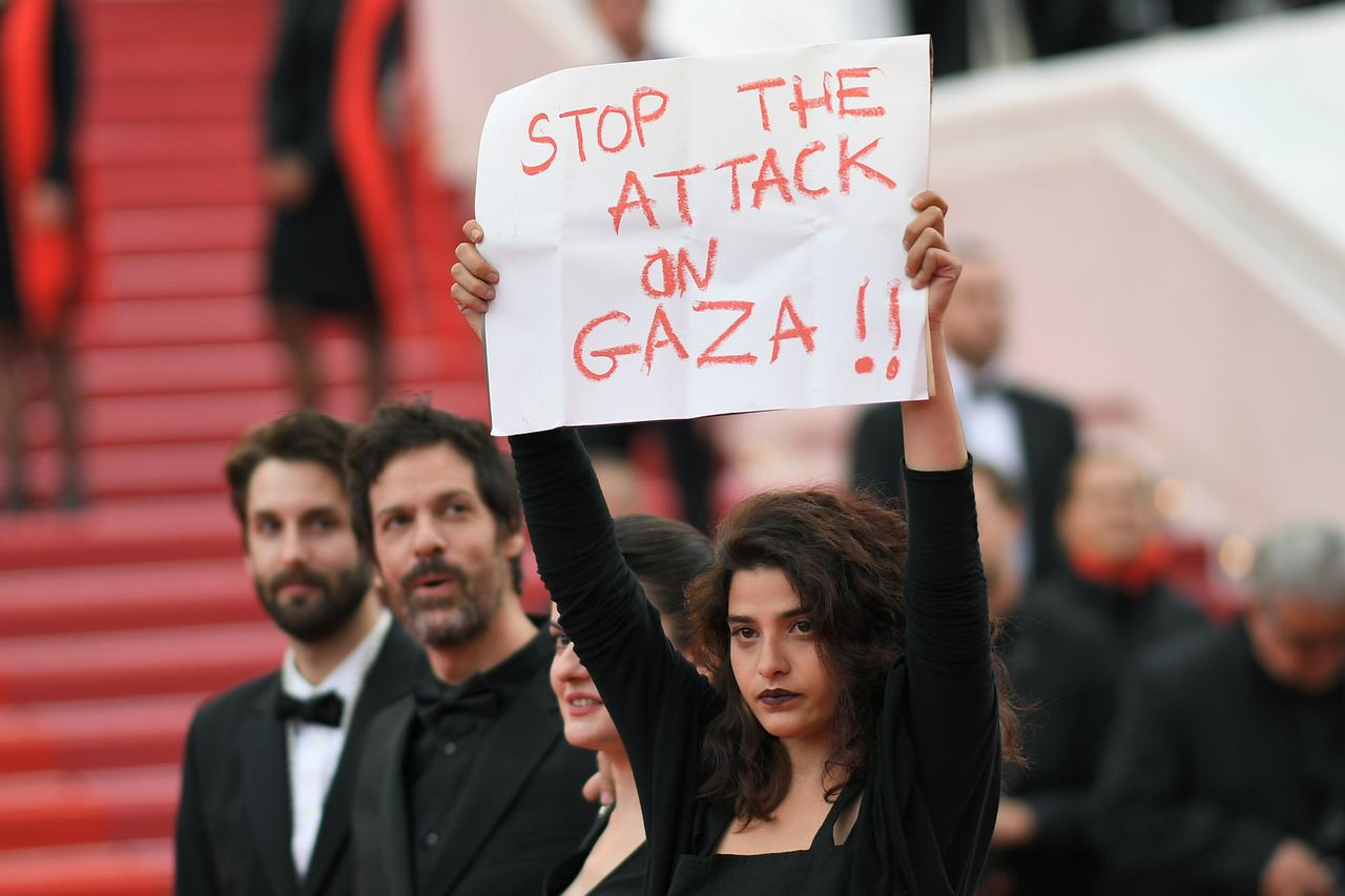 Filmmakers protest in solidarity with Palestine at Cannes